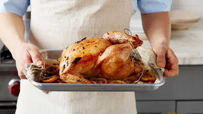man-holding-roasted-chicken-opener-2-158-d113040_horiz.jpg